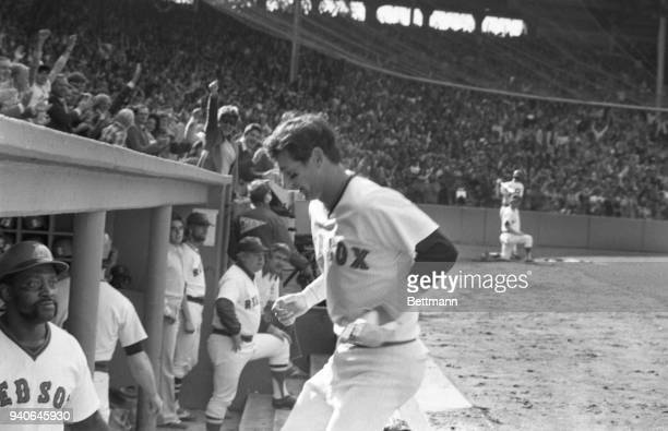 The captain of the Red sox, Carl Yastrzemski is all smiles after he belted a home run to lead of the 2nd inning of the Red Sox-Yankees sudden-death...