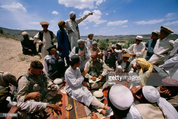 The captain Tommy Cardonne and his soldiers question the Pashtun population on the Talibans in the Pashtun tribal zone of Waziristan on July 2004 in...