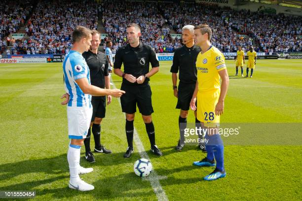 The captains Jonathan Hogg of Huddersfield Town and César Azpilicueta of Chelsea at the coin toss before the Premier League match between...