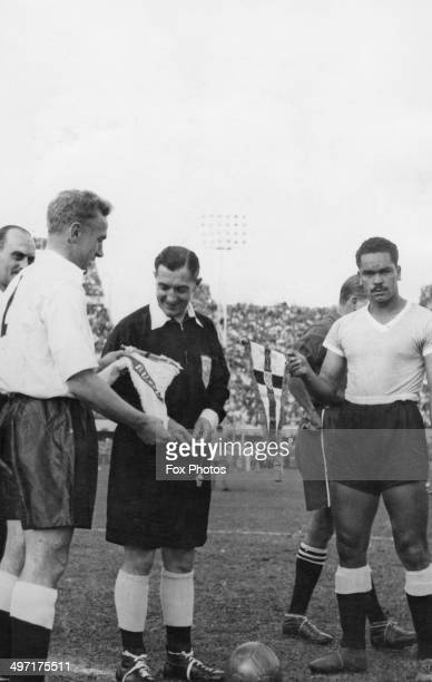 The captains of England and Uruguay Billy Wright and Matias Gonzales exchange pennants before an international match at Centenario 31st May 1953...