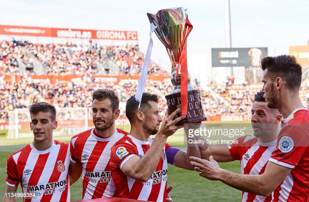 The captains of Girona FC shows the Supercopa de Catalunya to their fans before the La Liga match between Girona FC and Valencia CF at Montilivi...