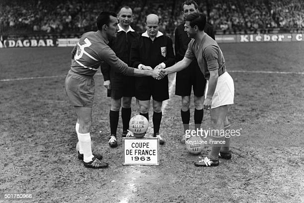 The captains of Olympique Lyonnais and AS Monaco teams shake hand before the final of the Football Coupe de France at the Parc des Princes stadium on...