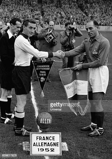 The captains of the German team Fritz Walter and France Roger Marche exchanging pennants before a friendly match France won 31