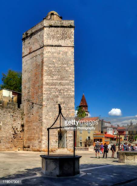 the captain'tower in the square of the 5 wells in zadar. - limestone pavement stock pictures, royalty-free photos & images