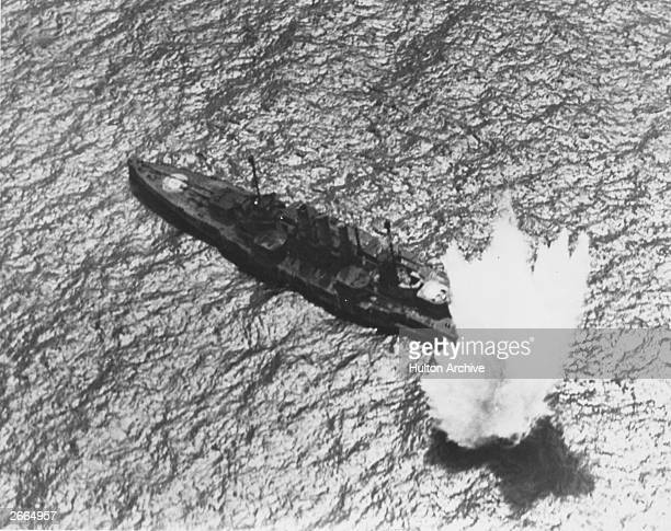 The captured German battleship Ostfriesland being bombed by US Army Air Corps aircraft, during tests on the effects of aerial bombing on warships.