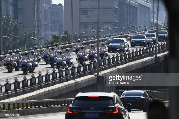 The car believed to be carrying North Korean leader Kim Jong Un is escorted by motorcycles in Beijing on June 19 2018 North Korean leader Kim Jong Un...