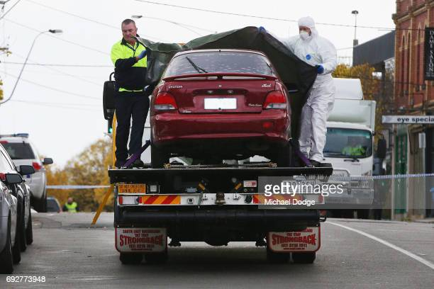 The car believed to be previously driven by Yacqub Khayre is taken out of service apartments while investigations take place on June 6 2017 in...