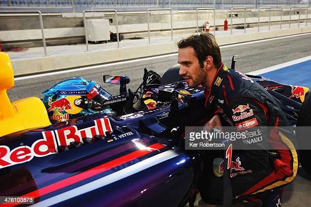The car driven by Sebastian Vettel of Germany and Infiniti Red Bull Racing suffers a fault and comes to a halt outside the garage of JeanEric Vergne...