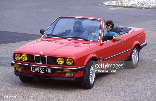 The car driver Cyril Neveu tests a convertible BMW 325 in 1986 le pilote automobile Cyril Neveu essai un cabriolet BMW 325 I en 1986