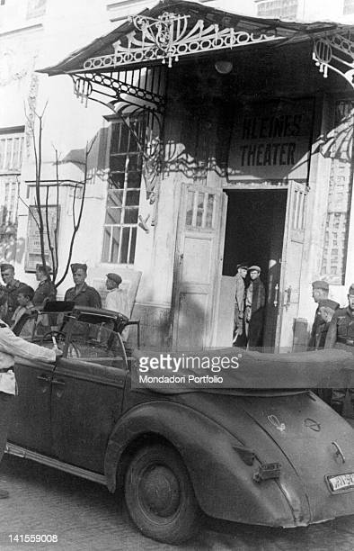 The car of a highranking German army officer is parked outside the theatre Krasnodar October 1942
