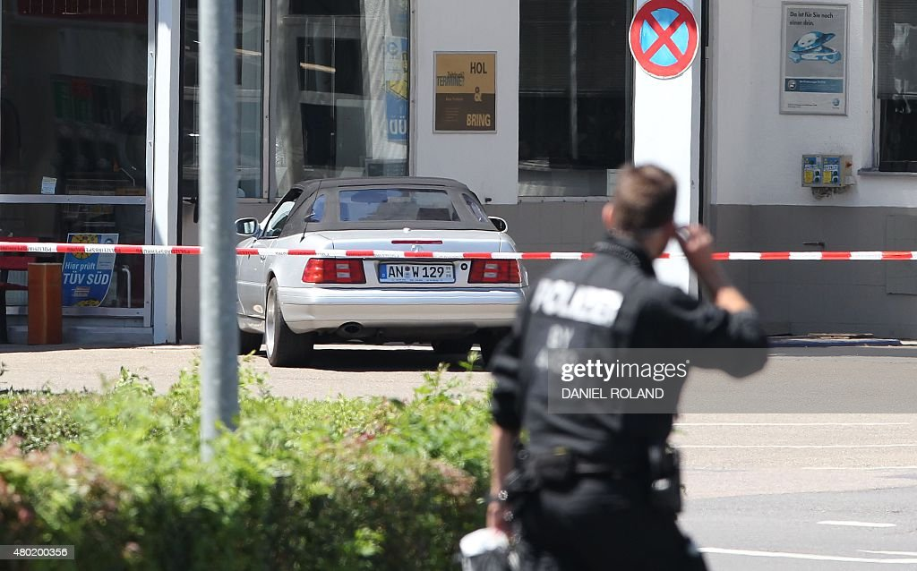 Bad Ansbach the car of an arrested gunman is seen at a petrol station in bad