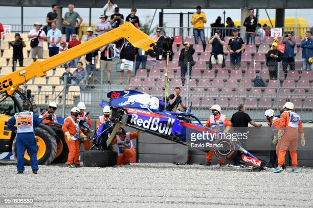 The car of Brendon Hartley of New Zealand and Scuderia Toro Rosso is recovered from the track after he crashed during final practice for the Spanish...