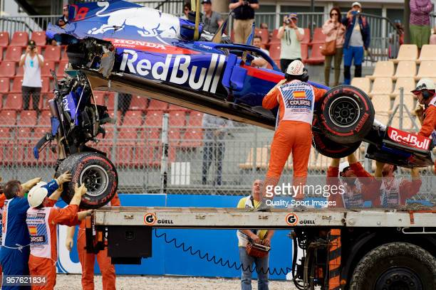 The car of Brendon Hartley of New Zealand and Scuderia Toro Rosso is recovered from the track after he crashed during final practice for Spanish...