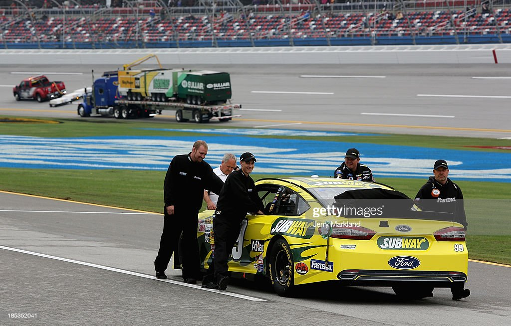 The car of Carl Edwards, driver of the #99 Subway Ford, is pushed back to the garage after qualifying for the NASCAR Sprint Cup Series 45th Annual Camping World RV Sales 500 ws cancelled due to rain at Talladega Superspeedway on October 19, 2013 in Talladega, Alabama.
