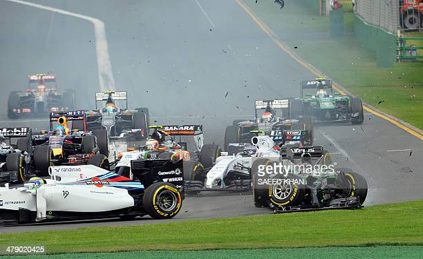 The car of Caterham-Renault driver Kamui Kobayashi of Japan veers off the track during an accident at the start of the Formula One Australian Grand...