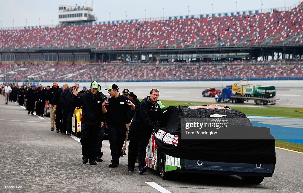 The car of Dale Earnhardt Jr., driver of the #88 Mountain Dew / XBox One Chevrolet, is pushed back to the garage after qualifying for the NASCAR Sprint Cup Series 45th Annual Camping World RV Sales 500 ws cancelled due to rain at Talladega Superspeedway on October 19, 2013 in Talladega, Alabama.