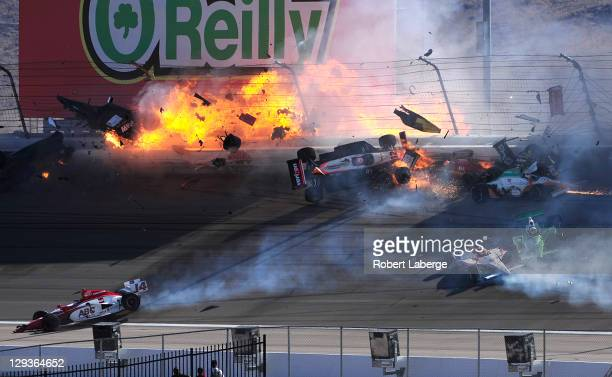 The car of Dan Wheldon driver of the Bowers Wilkins Sam Schmidt Motorsports Dallara Honda bursts into flames in a 15 car pile up including the Team...