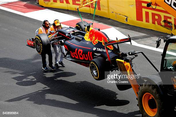 The car of Daniel Ricciardo of Australia and Red Bull Racing is removed from the track during practice for the European Formula One Grand Prix at...