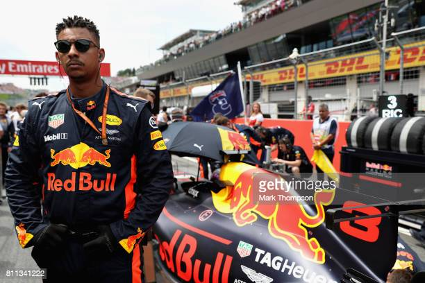 The car of Daniel Ricciardo of Australia and Red Bull Racing is prepared on the grid before the Formula One Grand Prix of Austria at Red Bull Ring on...