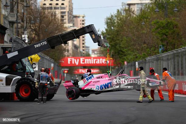 The car of Esteban Ocon of France and Force India is removed from the circuit during the Azerbaijan Formula One Grand Prix at Baku City Circuit on...
