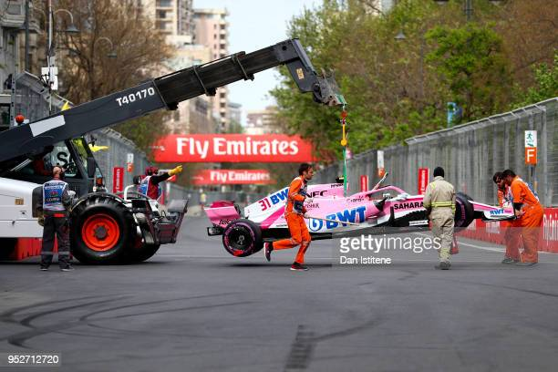 The car of Esteban Ocon of France and Force India is removed from the track after he retired during the Azerbaijan Formula One Grand Prix at Baku...