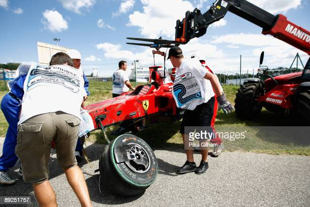 The car of Felipe Massa of Brazil and Ferrari is taken away on a flatbed truck following his accident during qualifying for the Hungarian Formula One...