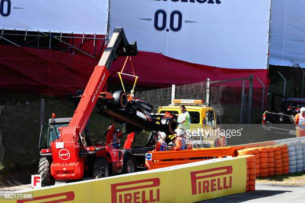 The car of Fernando Alonso of Spain and McLaren Honda is removed from the circuit after breaking down during practice for the Spanish Formula One...