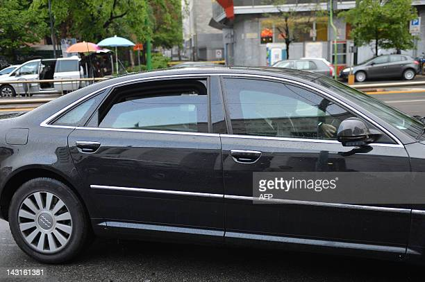 The car of former Italian prime minister Silvio Berlusconi arrives at Milan's courthouse for his first appearance at his trial for having sex with an...