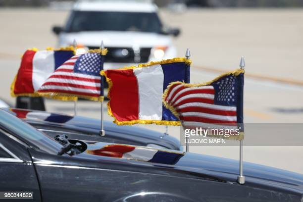 The car of French President Emmanuel Macron and his wife Brigitte Macron arrives at Joint Base Andrews in Maryland on April 23 2018 President Macron...