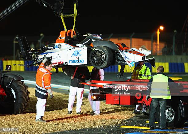 The car of Hideki Noda of Japan and Kruse Shiller Motorsport LolaMazda team is recovered after crashing during qualifying for the 76th running of the...