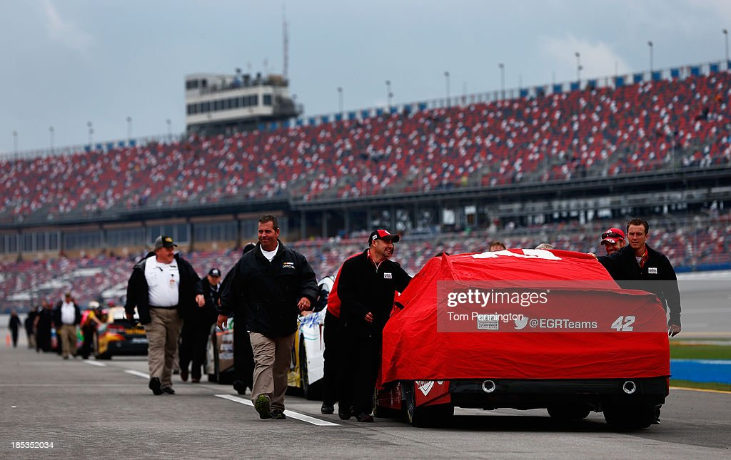 The car of Juan Pablo Montoya, driver of the #42 Target Chevrolet, is pushed back to the garage after qualifying for the NASCAR Sprint Cup Series 45th Annual Camping World RV Sales 500 ws cancelled due to rain at Talladega Superspeedway on October 19, 2013 in Talladega, Alabama.