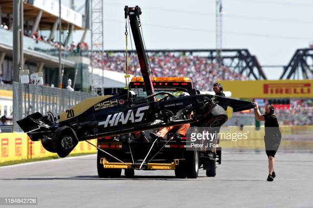 The car of Kevin Magnussen of Denmark and Haas F1 is removed from the circuit after he crashed during qualifying for the F1 Grand Prix of Canada at...