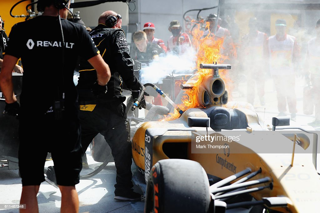 The car of Kevin Magnussen of Denmark and Renault Sport F1 on fire in the Pitlane during practice for the Malaysia Formula One Grand Prix at Sepang Circuit on September 30, 2016 in Kuala Lumpur, Malaysia.