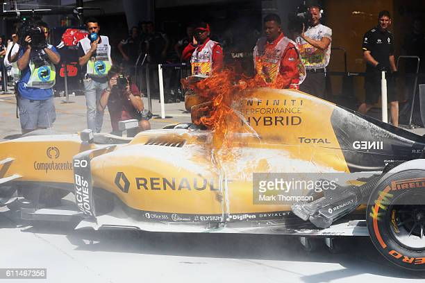 The car of Kevin Magnussen of Denmark and Renault Sport F1 on fire in the Pitlane during practice for the Malaysia Formula One Grand Prix at Sepang...