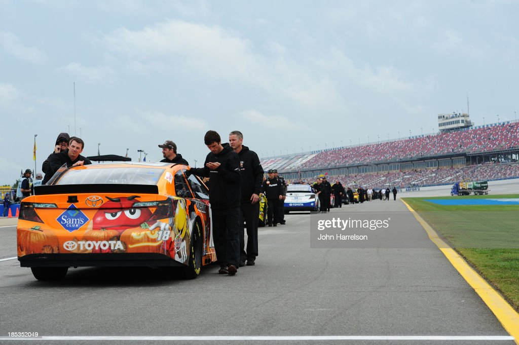 The car of Kyle Busch, driver of the #18 M&M's Halloween Toyota, is pushed back to the garage after qualifying for the NASCAR Sprint Cup Series 45th Annual Camping World RV Sales 500 ws cancelled due to rain at Talladega Superspeedway on October 19, 2013 in Talladega, Alabama.