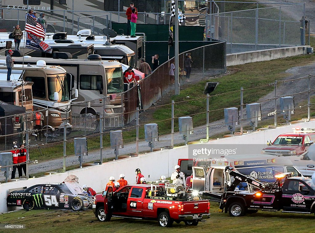 The car of Kyle Busch, driver of the #54 Monster energy Toyota, is seen against a wall after crashing during the NASCAR XFINITY Series Alert Today Florida 300 at Daytona International Speedway on February 21, 2015 in Daytona Beach, Florida. Busch was transported to a local hospital with a lower body injury and will not race in the NASCAR Sprint Cup Series Daytona 500 tomorrow.