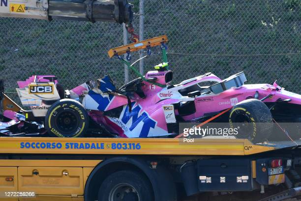 The car of Lance Stroll of Canada and Racing Point is seen on a tow truck following a crash during the F1 Grand Prix of Tuscany at Mugello Circuit on...