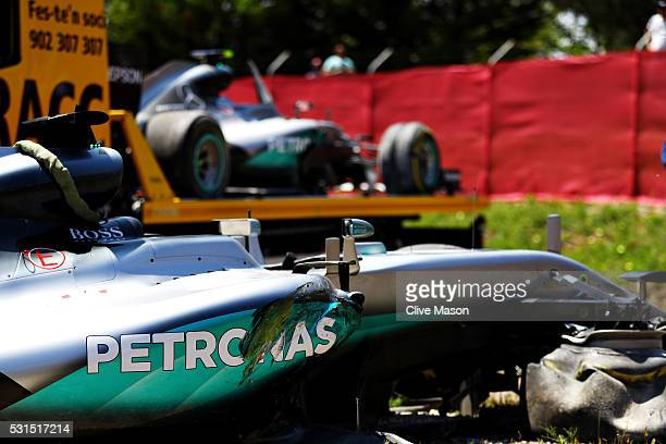 The car of Lewis Hamilton of Great Britain and Mercedes GP at the side of the track behind is the car of Nico Rosberg of Germany and Mercedes GP...