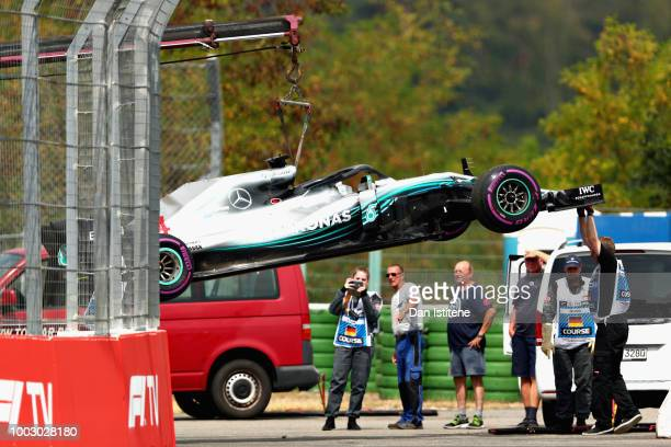 The car of Lewis Hamilton of Great Britain and Mercedes GP is removed from the circuit after stopping during qualifying for the Formula One Grand...