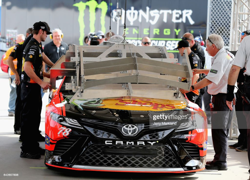 The car of Martin Truex Jr., driver of the #78 Bass Pro Shops/TRACKER BOATS Toyota, goes through inspection during practice for the Monster Energy NASCAR Cup Series 59th Annual DAYTONA 500 at Daytona International Speedway on February 18, 2017 in Daytona Beach, Florida.