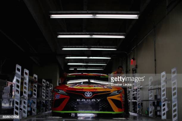 The car of Matt Kenseth driver of the Tide Pods Toyota goes through inspection during practice for the Monster Energy NASCAR Cup Series Bank of...