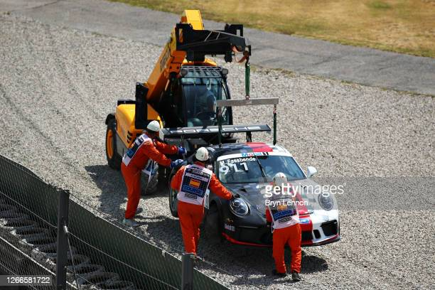 The car of Michael Fassbender of Ireland and Porsche Motorsport is removed from the circuit during the Porsche Mobil 1 Supercup at Circuit de...