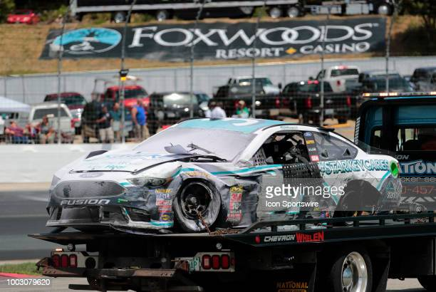 The car of Michael McDowell Monster Energy NASCAR Cup Series driver of the Starkey Hearing Foundation Ford is towed back to the garages after hitting...