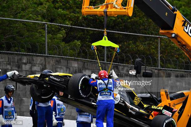 The car of Nico Hulkenberg of Germany and Renault Sport F1 is removed from the circuit after he crashed during practice for the Formula One Grand...