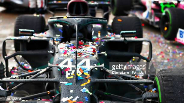 The car of race winner Lewis Hamilton of Great Britain and Mercedes GP is pictured covered in confetti as he celebrated winning a 7th F1 World...