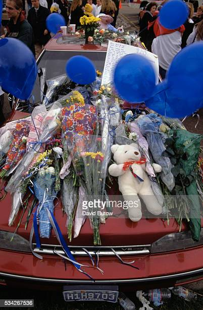 The car of Rachel Scott a victim of the Columbine shooting is covered with memorial bouquets and balloons In May of 1999 students Eric Harris and...