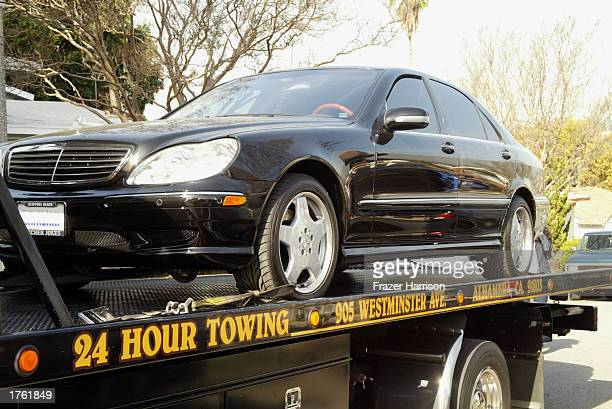 The car of record producer Phil Spector is returned to his home on February 4 2003 in Alhambra California Spector was arrested on February 3 2003 for...
