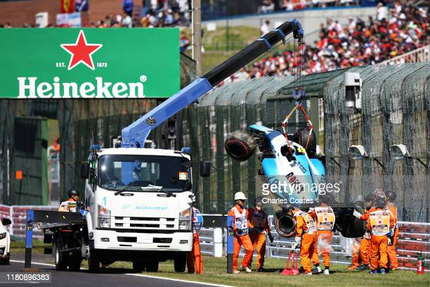 The car of Robert Kubica of Poland and Williams is removed from the circuit after he crashed during qualifying for the F1 Grand Prix of Japan at...
