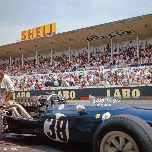 The car of Swiss racing driver Joseph Siffert at the pit stop, circa 1966.