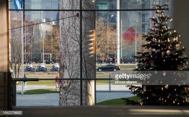 The car of the Greek Prime Minister Alexis Tsipras accompanied by motorbikes drives towards the German Chancellery in Berlin Germany 16 December 2016...